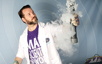 Mad scientist holding a tube with smoke surrounding it
